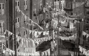 cropped_clothes_hanging_out_of_tenement_building_windows